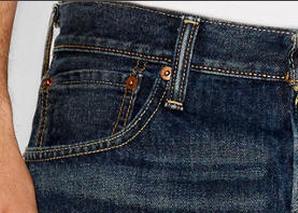 why small repeat buttons in jeans pocket