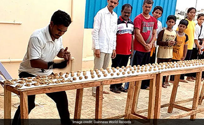 andhra pradesh man smashes 212 walnuts in one minute